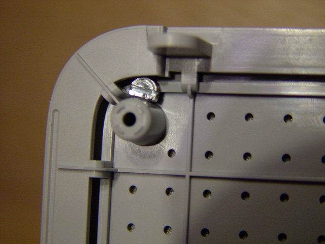 the back with extra holes and a screw with a chunk off.